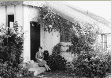 Marjory Stoneman Douglas on the steps of her house in Coconut Grove FL (Photo credit: Florida Park Service)