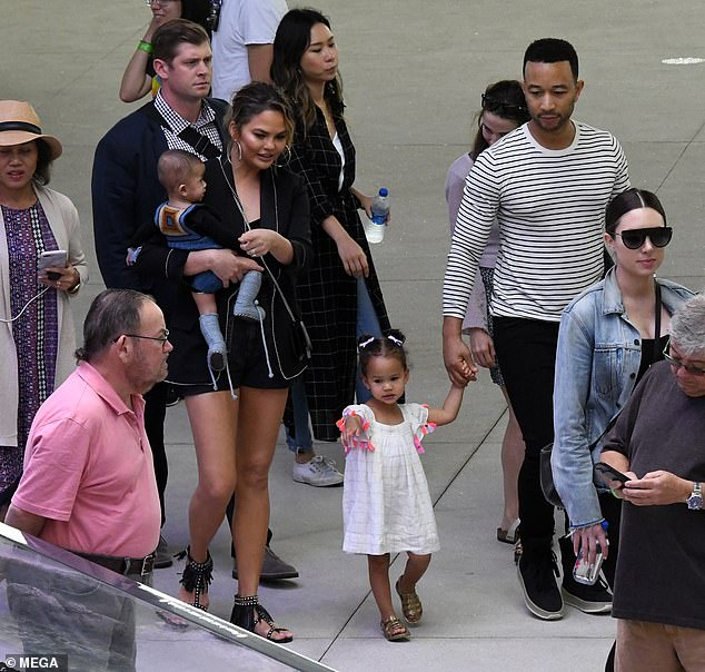 John Legend, Chrissy Teigen, and their children at the Phillip and Patricia Frost Museum of Science