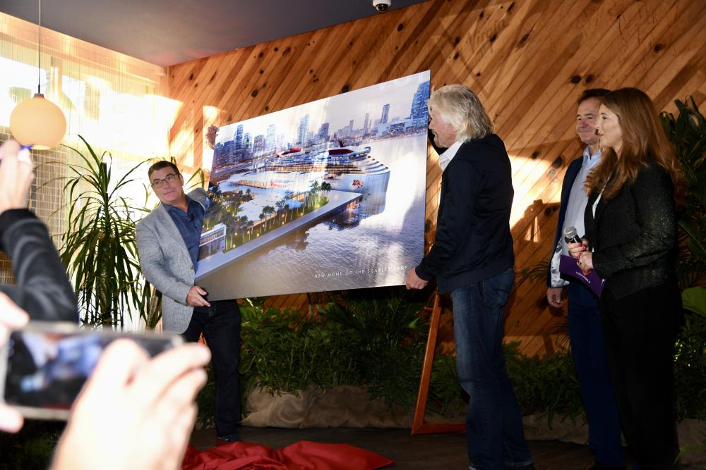 Virgin Voyages CEO Tom McAlpin and Sir Richard Branson holding a rendering of the proposed terminal